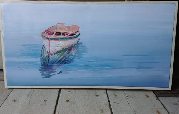Framed painting of boat on lake