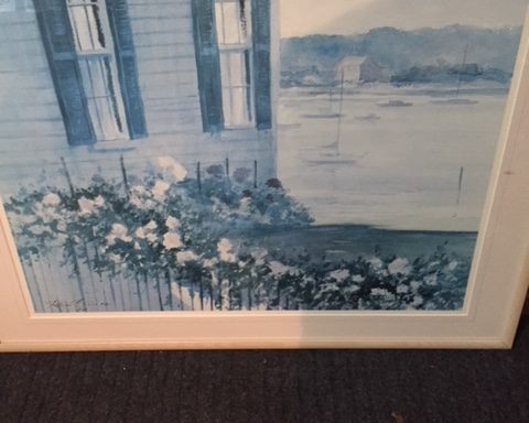 Framed lake house painting